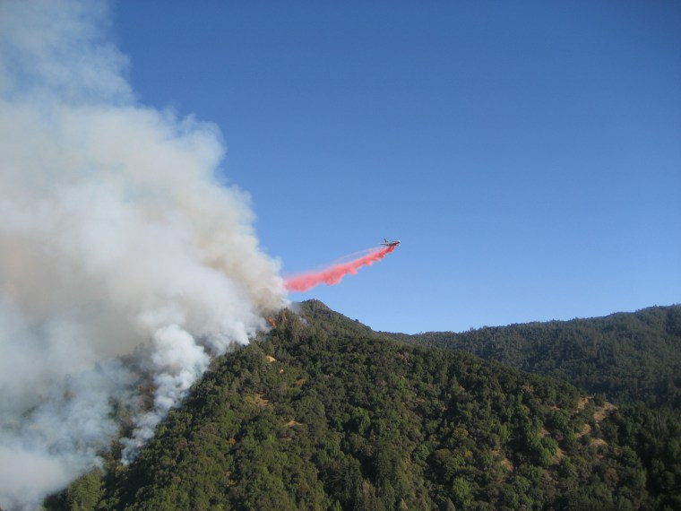 A DC-10 drops fire retardant on part of the fire in the Los Padres National Forest.