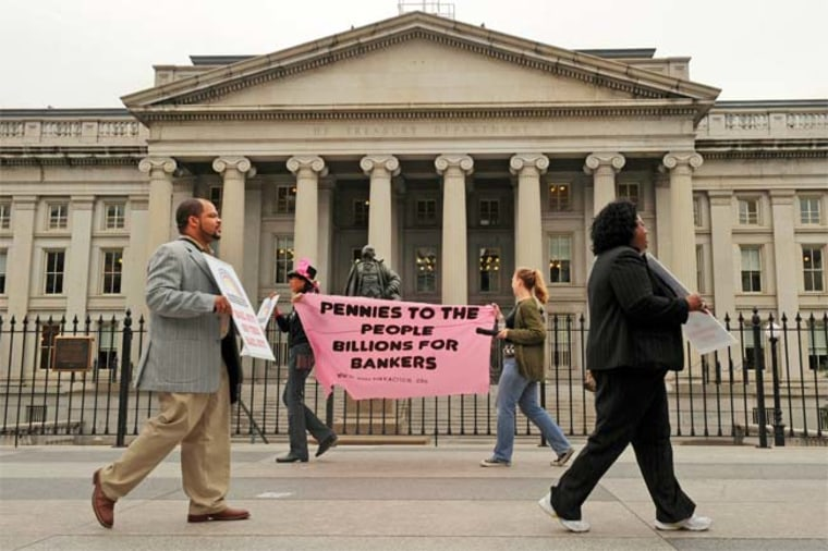 Protesters march outside of the U.S Treasury building in protest of the proposed Wall Street bailouts, Friday Sept. 26, 2008, in Washington. Credit: AP Photo / Jacquelyn Martin.