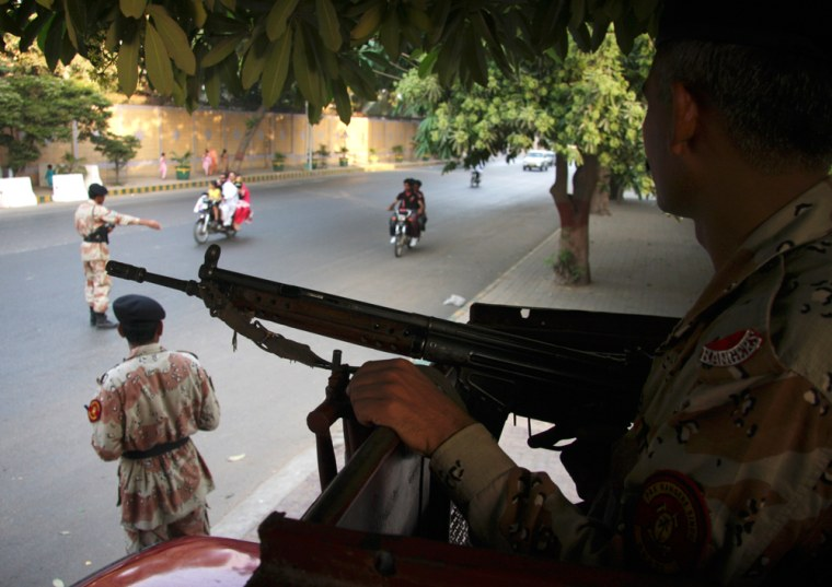 Image: Soldiers of Pakistan's paramilitary force stop vehicles on a checkpoint in Karachi