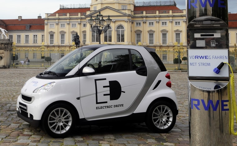 Daimler has developed the all-electric Smart ED, seen here with one of the charging stations that will be used in Berlin, Germany, to test the vehicles.