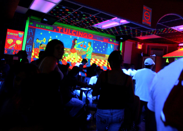 Image: The Tulcingo Bar is packed with patrons and employees in Queens, New York