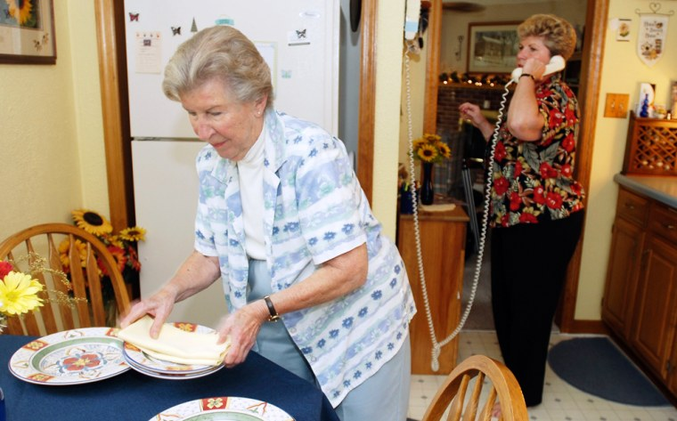 Susan Martin, right, and her mother Betty Gresick prepare for dinner at Martin's home in Claymont, Del. Gresick, 84, retired from a family electronics business, at age 82, but does not have a retirement fund of her own.