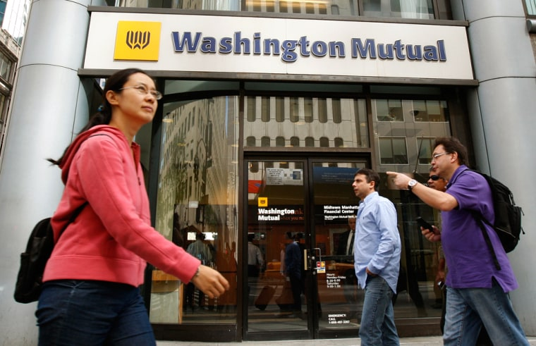 Pedestrians walk past a Washington Mutual bank branch in New York City