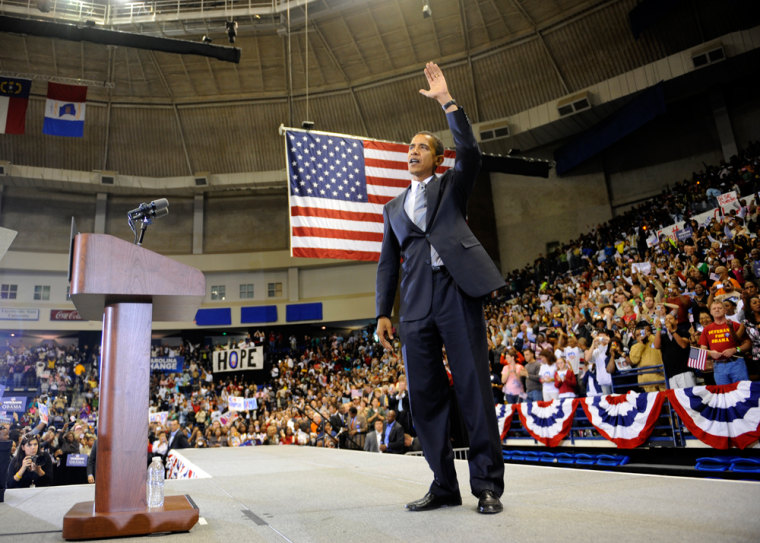 Image: Barack Obama waves during a rally