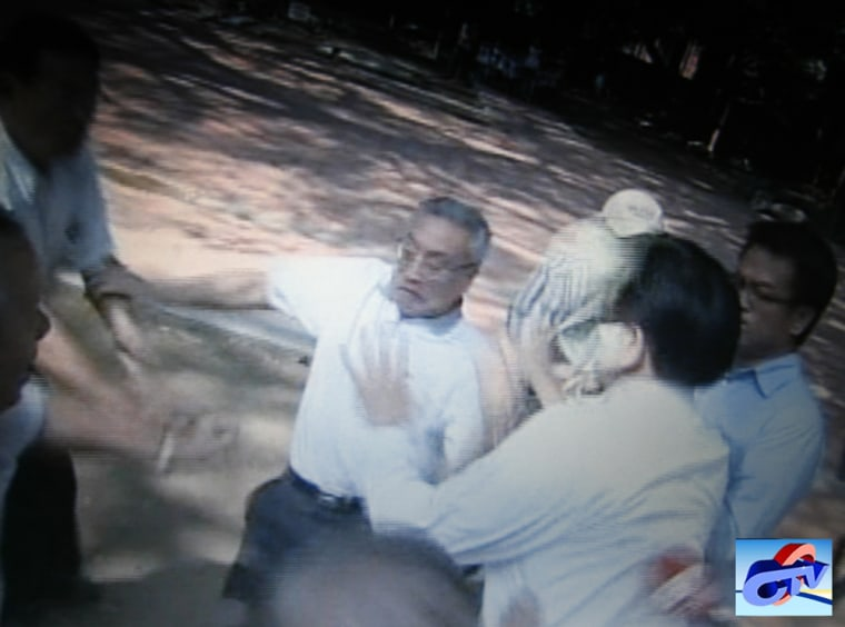 Image: An image from television footage shows Zhang Mingqing falling after he was pushed by protesters during a visit to a temple in Tainan