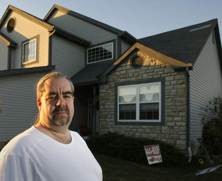 Jack Needles stands in front of his home in Hilliard, Ohio. Needles is facing his second layoff in six years amid weak economic conditions.