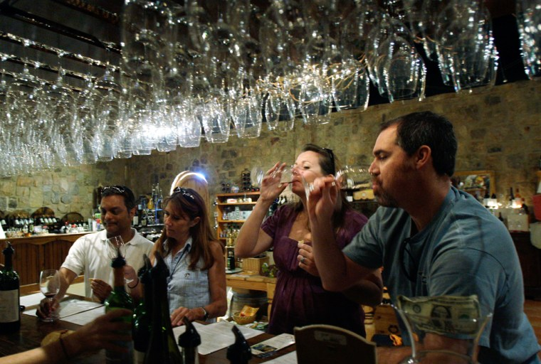 Visitors taste wine at the Torre di Pietra winery in Fredericksburg, Texas.