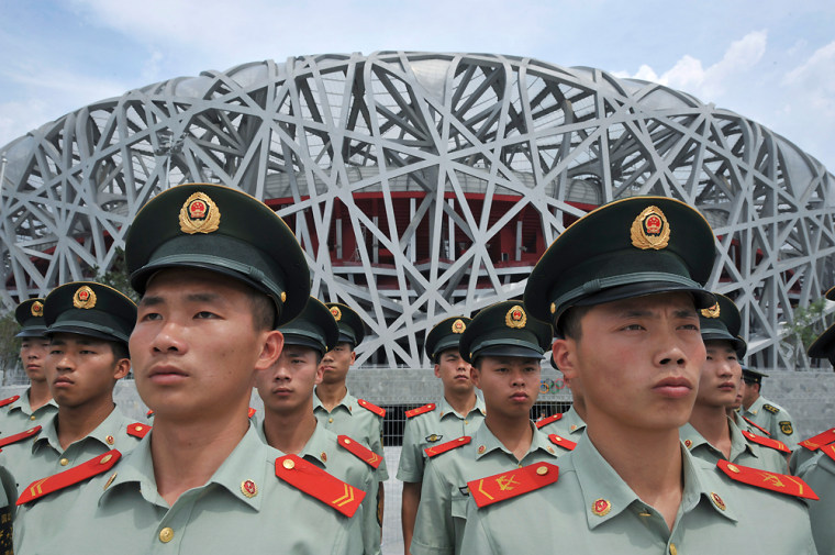 Paramilitary policemen stand in front of the National Stadium at the Olympic Green in Beijing