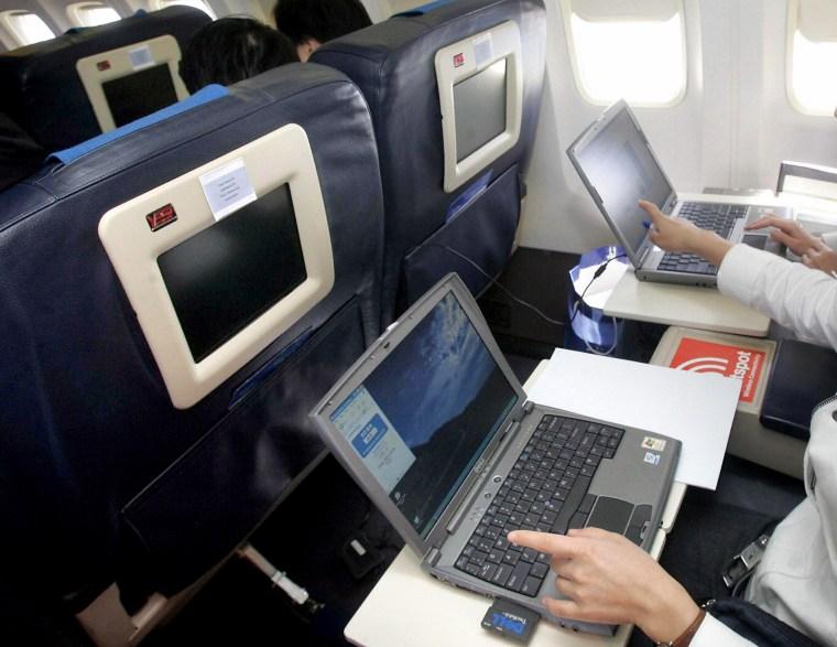 Image: Testing laptops on airplane