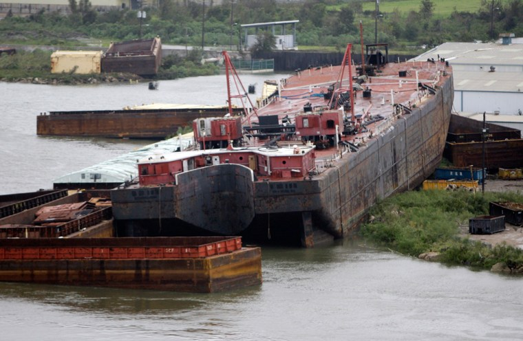 Image: Ships and barges that broke moorings and ran aground