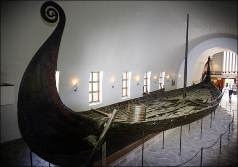 he Oseberg The body of a Viking queen and another female, along with multiple artifacts, were exhumed from the grass-covered Viking Oseberg mound in the county of Vestfold in south Norway. This picture shows the Oseberg ship at the Viking Ship Museum in Oslo.
