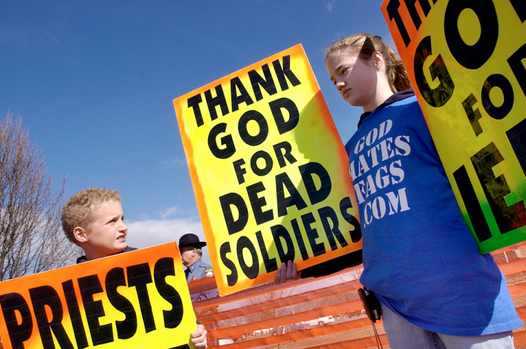 Westboro Baptist Church member Gabriel Phelps-Roper, 10, and his sister Grace Phelps-Roper, 13, both of Topeka, Kan., protest at the funeral of Marine Lance Cpl. Matthew A. Snyder in Westminster, Md., March 10, 2006.