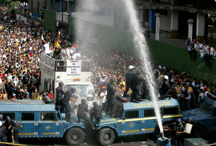 Police use a water cannon in CaracasThursday to disperse demonstratorswho protest constitutional reforms that would permit President Hugo Chavez to run for re-election indefinitely.