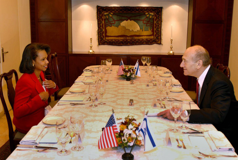 U.S. Secretary of State Condoleezza Rice speaks with Israel Prime Minister Ehud Olmert in Jerusalem onSunday.