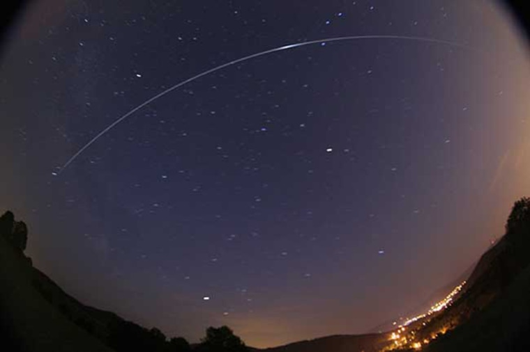 In a time-exposure photograph, the international space station can be seen streaking across the sky over the town of Nydek in the Czech Republic in June 2007.
