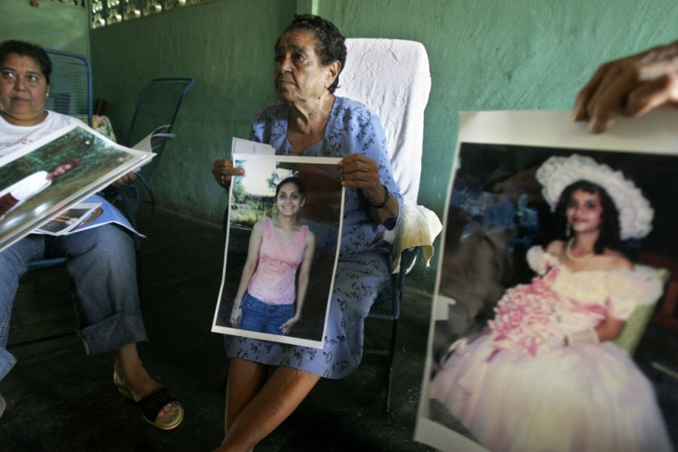Gioconda Reyes, left ,and Alicia Perez, relatives of Olga Reyes, show photographs during an interview in Nagarote, west of Managua, Nicaragua. Reyes, a 22-year-old law student whose fetus developed outside her uterus, a condition known as an ectopic pregnancy, died on April 11, 2007.