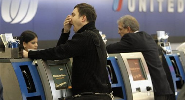 Image: Passengers check in