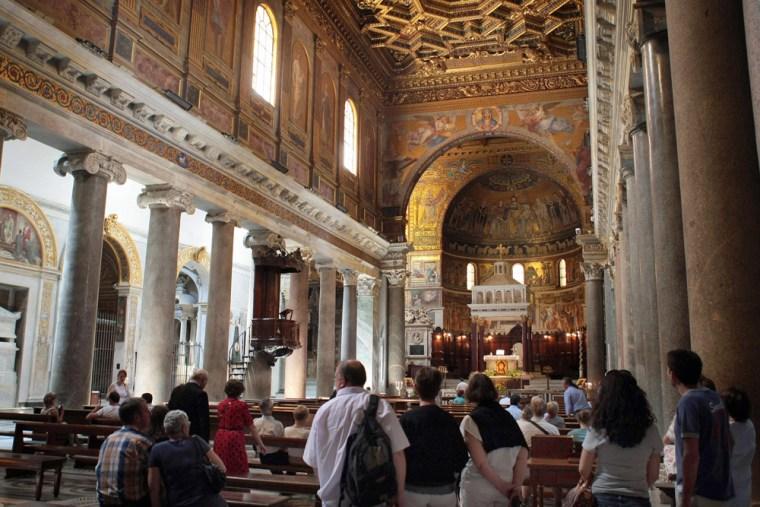 Tourists visit the Basilica of Santa Mar