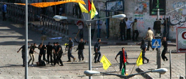 Image: Hamas security force officers hit a Palestinian Fatah supporter with clubs