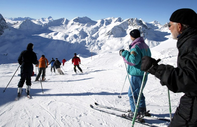 Skiers are shown on their way down the 3,000 meter peak of Piz Nair in St. Moritz, Switzerland. Interest in exotic ski destinations is being driven in part by more aggressive marketing by resorts in places like South America and New Zealand, and partly because there are more international flights available, so trips are easier to plan.