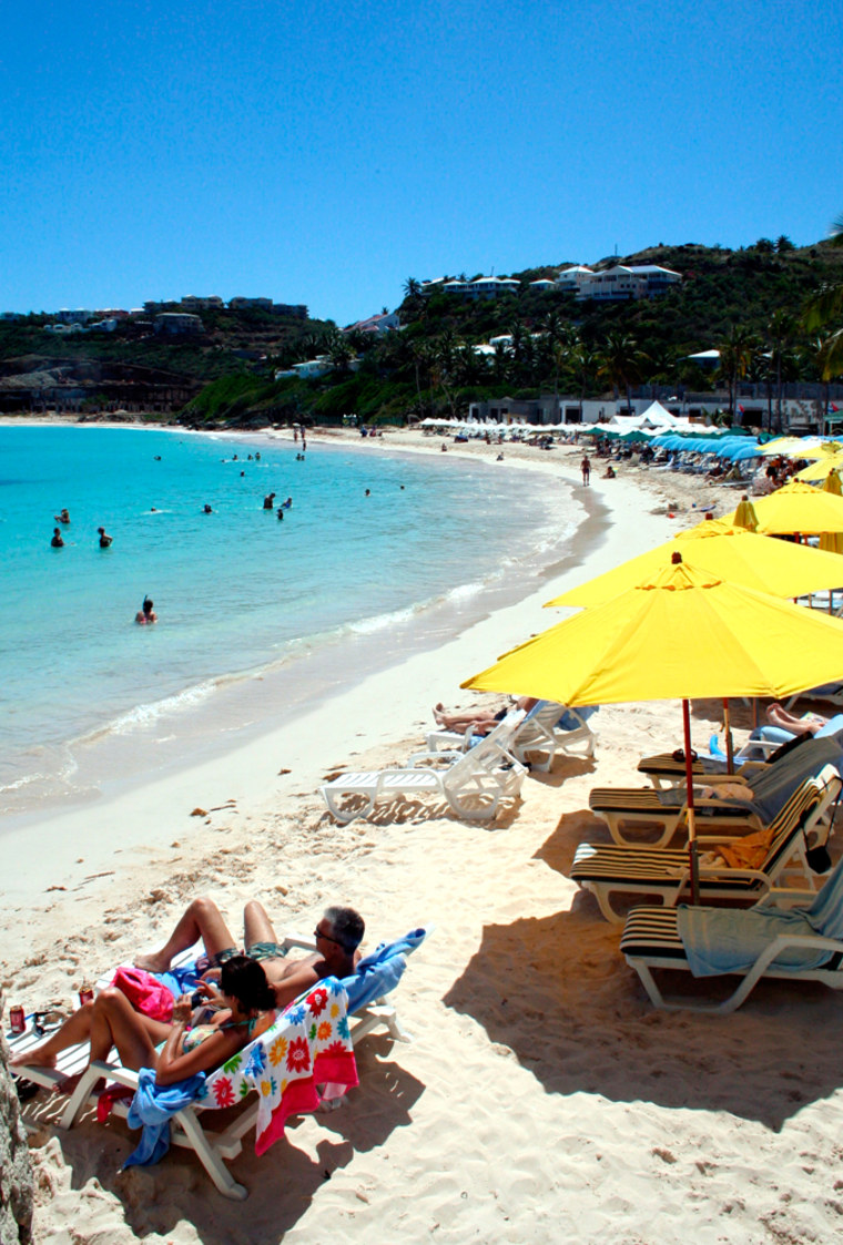 People relax and swim on Oyster Beach on the 37-square-mile island of St. Martin in the northeast Caribbean. It is half French-owned, part of the French West Indies, and half Dutch territory, listed among the Netherlands Antilles — but there is no real border