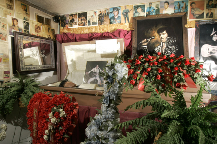 A wax figure rests in a casket in a funeral scene at the Elvis is Alive Museum on Oct. 31 in Wright City, Mo.