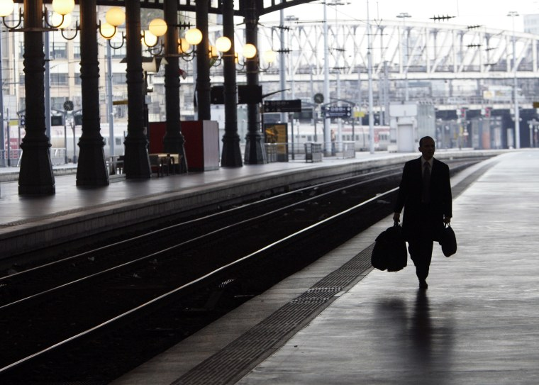 A man walks on a platform at the Gare du Nord train station in Paris, on Wednesday, as striking transport workers slowed France to a crawl.