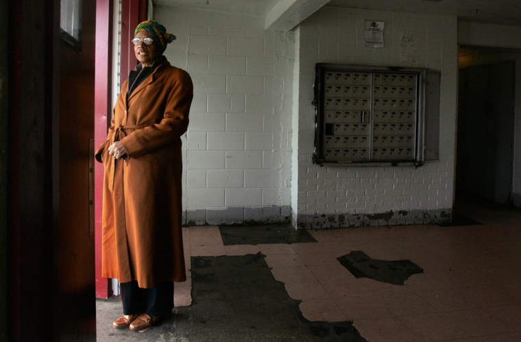 Image: Jacqueline Thompson looks out from the lobby of the building at the Harold Ickes Homes public housing project just south of downtown Chicago.