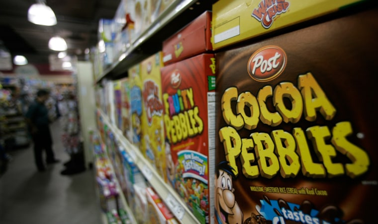 Shares of Kraft Foods Inc. climbed Monday after a published report said the nation's biggest food and beverage maker was nearing a deal to sell its Post cereal division for about $2.6 billion.
