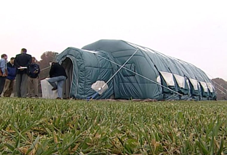 An inflatable prototype for a lunar habitat goes on display at ILC Dover's Delaware facility. The structure can be put up in a matter of minutes, NASA says.
