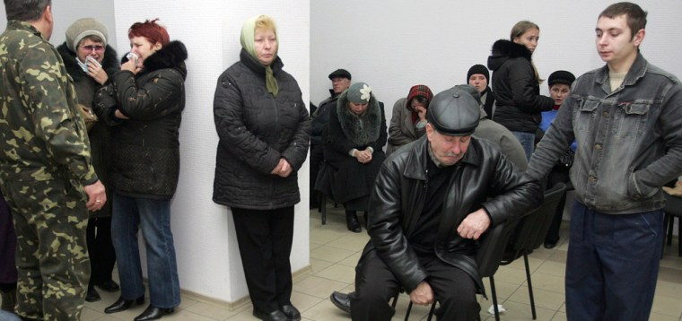 Image: Miners' relatives wait for news