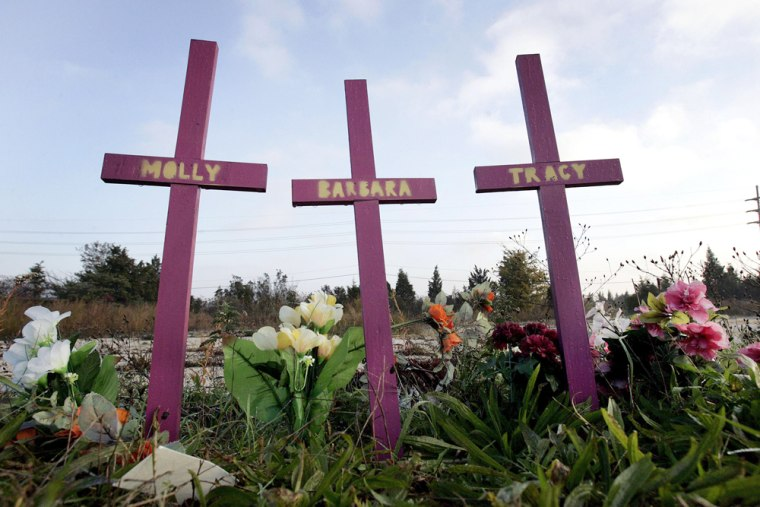 Image: Three crosses stand, surrounded by flowers, in Egg Harbor Township