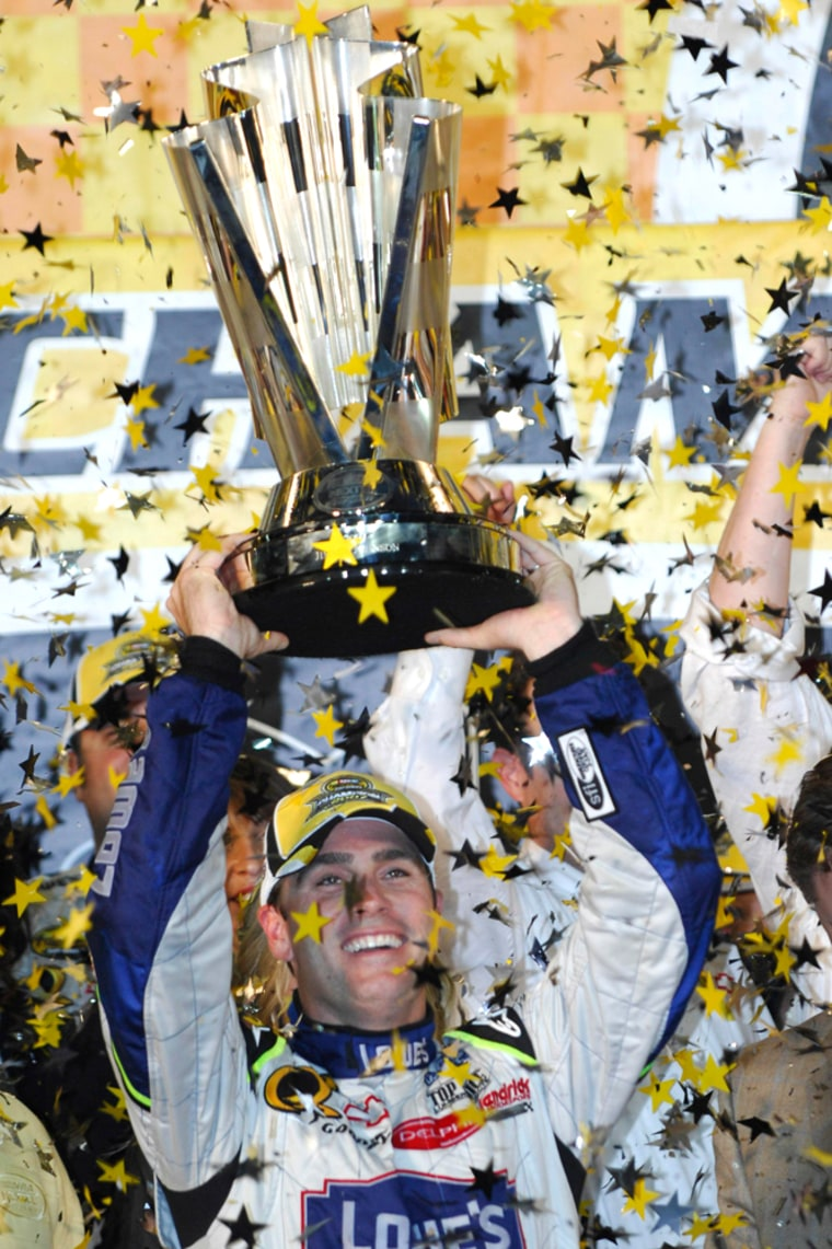 Image: Jimmie Johnson celebrates winning the NASCAR Nextel Cup championship