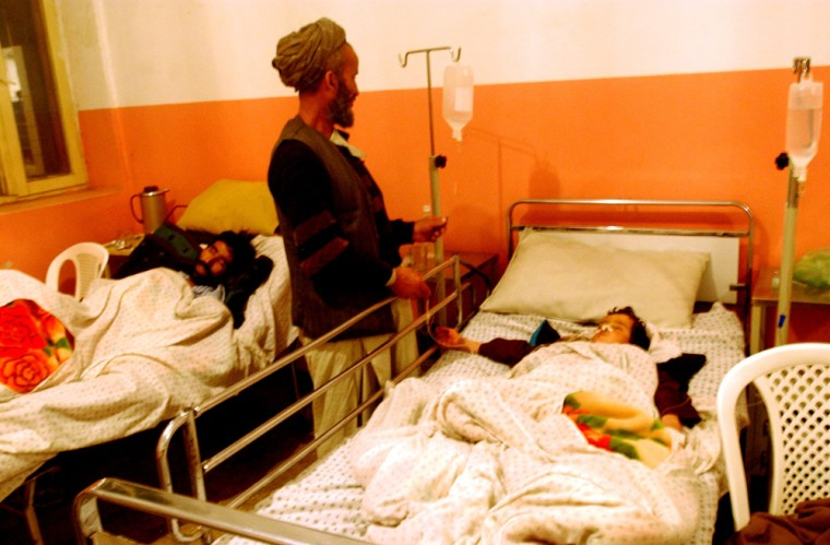 Image: A young Afghan suicide blast victim lies in his hospital bed in Baghlan
