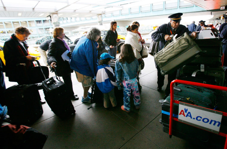 Image: Travelers wait to check in for flight at New York's LaGuardia Airport prior to Thanksgiving holiday