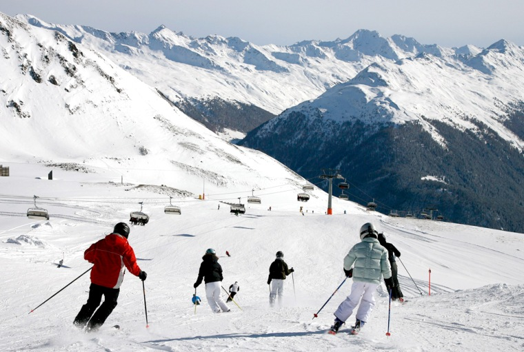 Skiers enjoy the perfect conditions with a lot of fresh fallen snow and blue skies on Nov. 18 on the Weissfluhjoch mountain above Davos in southeastern Switzerland. Due to the early and rich snowfalls many ski resorts in the Swiss mountains already opened for the new season this weekend.