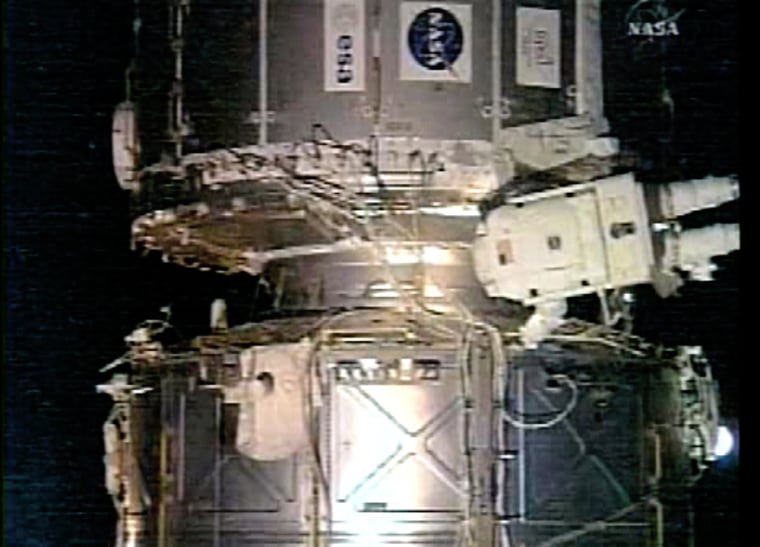 Image: Astronaut  works on the international space station