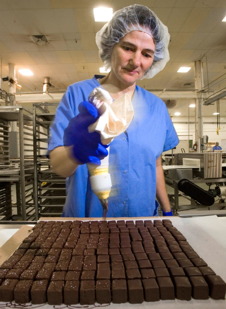 Sandra Bessert decorates petits fours by hand on the line at The Swiss Colony in Monroe, Wis. The catalog company's bakery produces nearly 54 million petits fours per year, with most sold during the Christmas season.