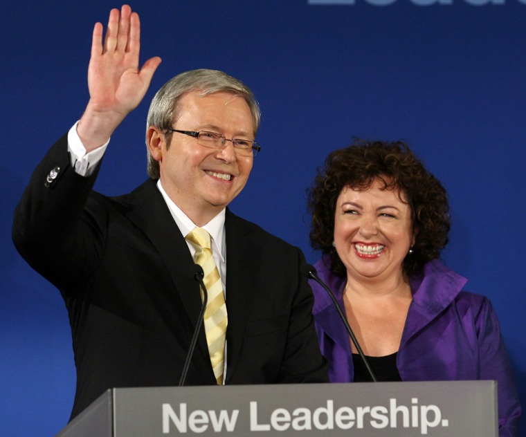 Image: Labor leader and new Prime Minister of Australia Kevin Rudd stands next to his wife Therese Reine