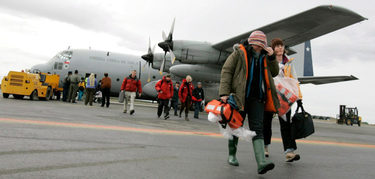 Image: Survivors from the Explorer cruise ship arrive at the airport in Punta Arenas