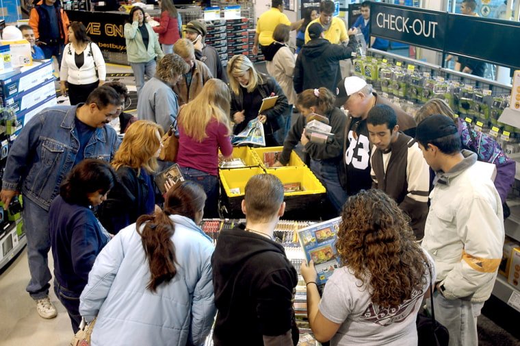 Image: Shoppers crowd the aisles of Best Buy in search of post-Thanksgiving bargains