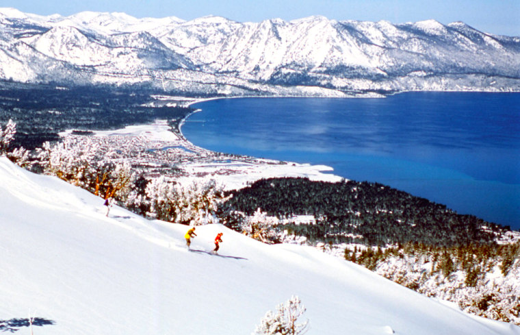 Skiers are seen making their way down the slopes at Heavenly Ski Resort in South Lake Tahoe, Calif. The resort's Olympic double chair has beenreplaced with a high-speed quad that will provide improved access to recently gladed woods and three new trails.