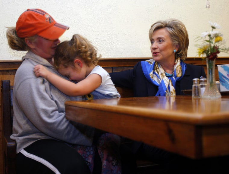Four-year-old Carly hides her face while her mother talks to Democratic presidential candidate U.S. Senator Clinton in Exeter