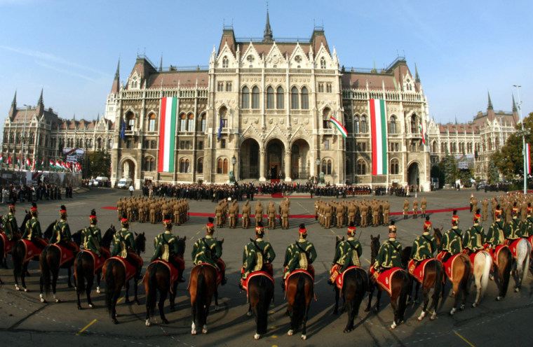 Image: Hungarian soldiers attend an official ceremony in front of the parliament building in Budapest.