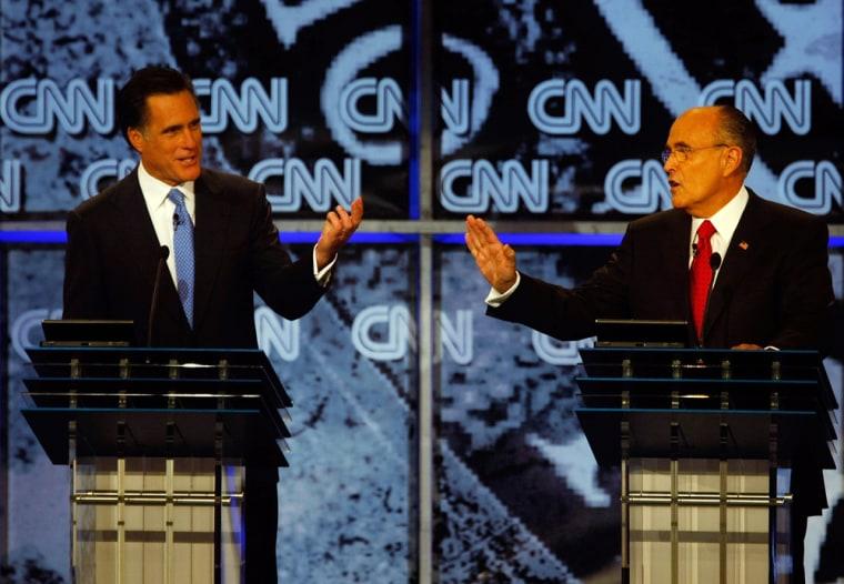 Image: Former Massachusetts governor Mitt Romney (L) and former New York City Mayor Rudy Giuliani.