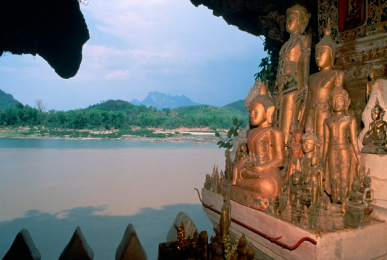 Image: Statues of Buddhist Deities in the Sacred Caves of Pak Ou, Laos
