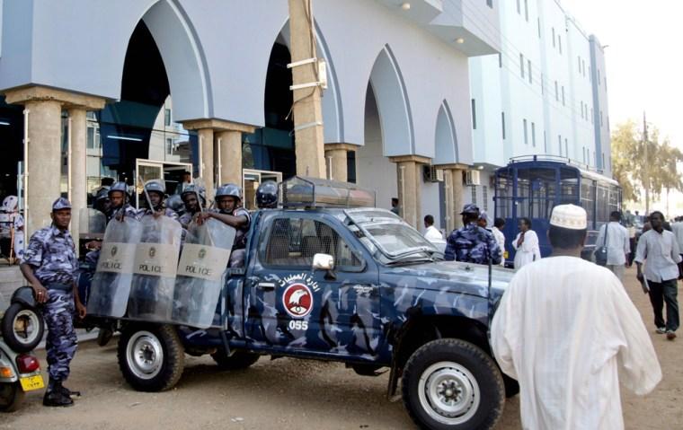 Sudanese anti-riot policemen stand alert outside theKhartoum court on Thursday.