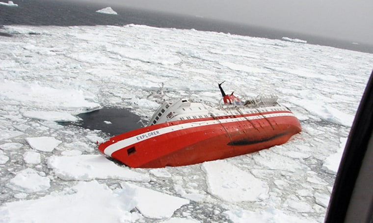 Image: The Liberian-flagged Explorer cruise ship is seen sinking after it hit an object in Antarctic waters.