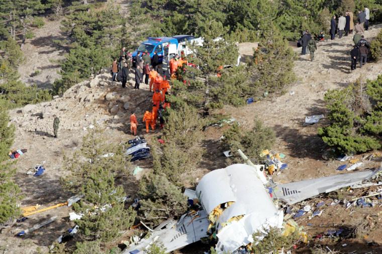 Image: The wreckage of AtlasJet Airline MD-83 lies on the hills near Cukuroren village.