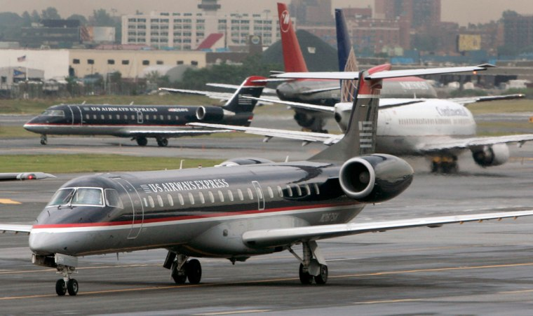 Image: Commercial jetliners are seen the tarmac at LaGuardia airport